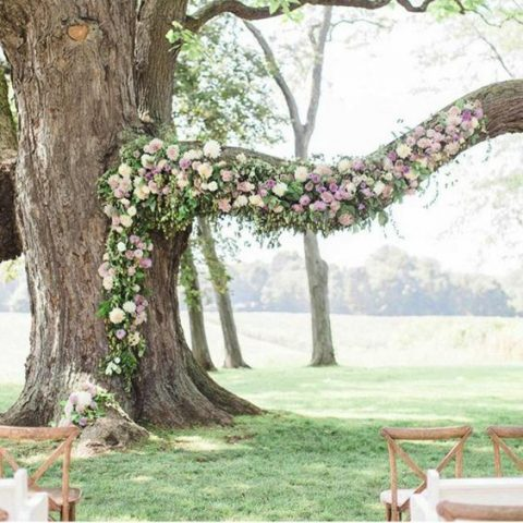 a tree with lavender, blush and neutral florals and greenery