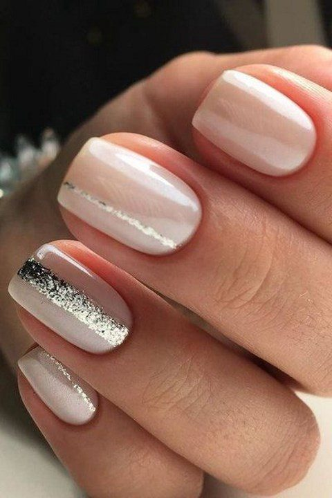 neutral nails with glitter stripes for a chic look