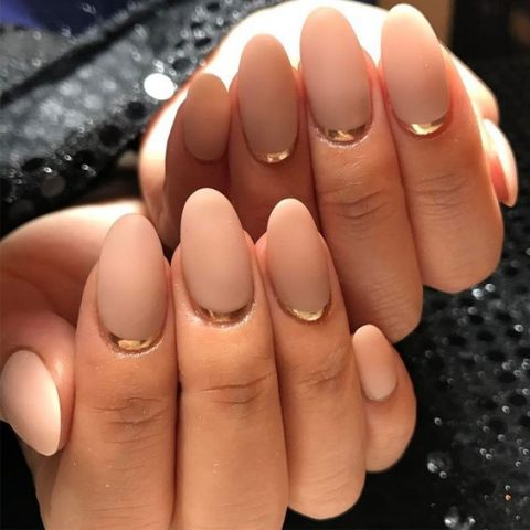 nude nails with a gold leaf touch