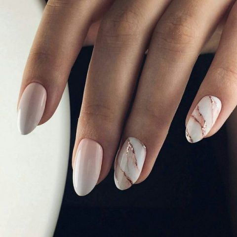 ombre French manicure and two marble nails with rose gold touches