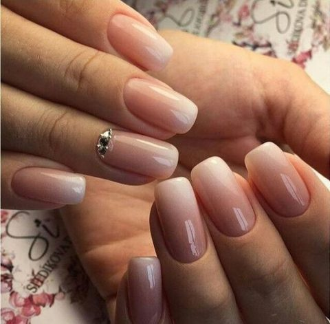 ombre French nails with a rhinestone accent