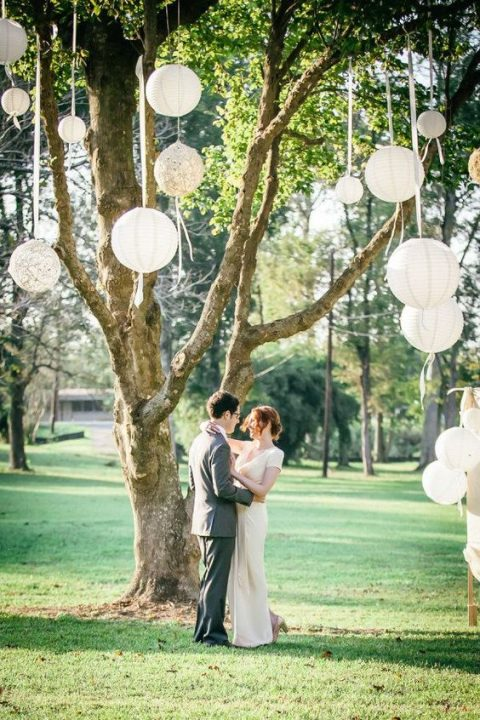paper and macrame lanterns not only create a dreamy ceremony space but also make a nice photo backdrop