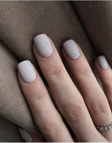 white matte nails with touches of silver glitter