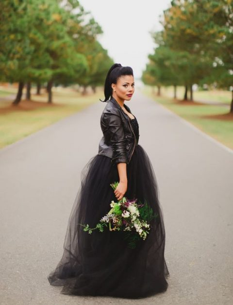 a black strapless A-line wedding dress and a black leather jacket