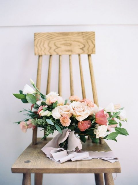 a blush and dusty pink bouquet with greenery and grey ribbons
