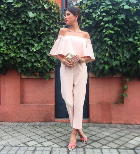 a blush off the shoulder ruffle neckline jumpsuit, pink heels and a metallic clutch