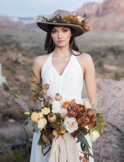 a brown hat decorated with greenery and flowers