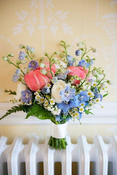 a chic bouquet with pink, blue and white blooms plus ferns and daisies