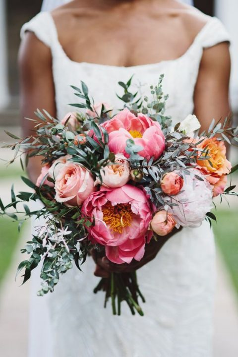 a chic wedding bouquet with blush, pink and white blooms and greenery