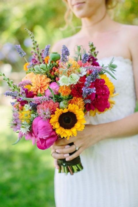 a colorful bouquet with pink, red, orange, lilac and yellow blooms