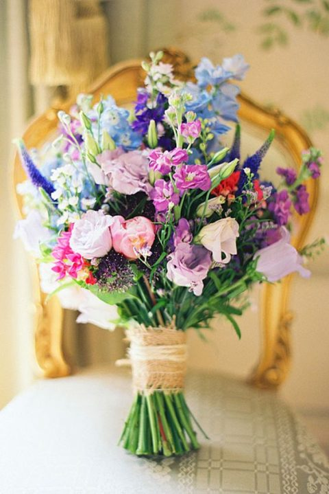 a colorful summer bouquet with blue, purple, lilac, blush and pink flowers