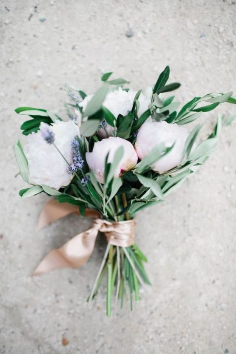 a cute bouquet with blush peonies, lavender and some greenery