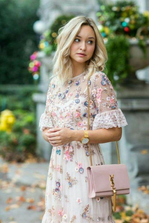 a cute creamy embroidered dress with lace sleeves and embellishments plus a pink clutch