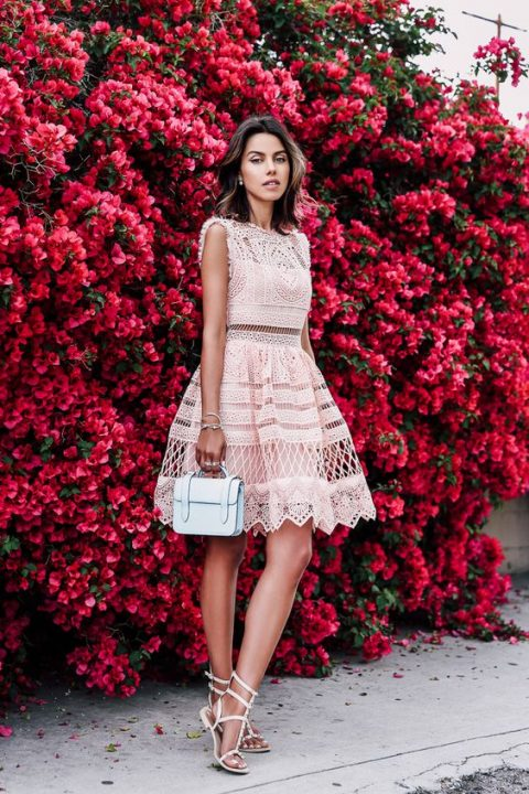 a fit and flare pink lace dress paired with pink gladiator sandals
