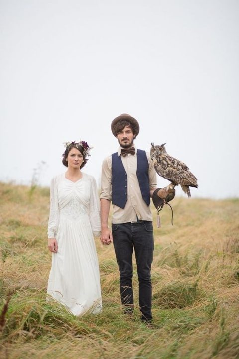 a hat adds a relaxed boho feel to the groom_s look