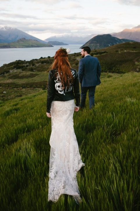 a mermaid lace wedding dress with a black handpainted leather jacket
