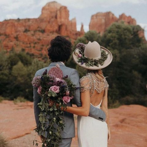 a neutral hat with greenery and blooms