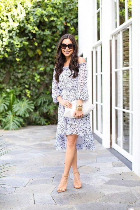a printed off the shoulder high low dress with long sleeves, nude shoes and a white clutch
