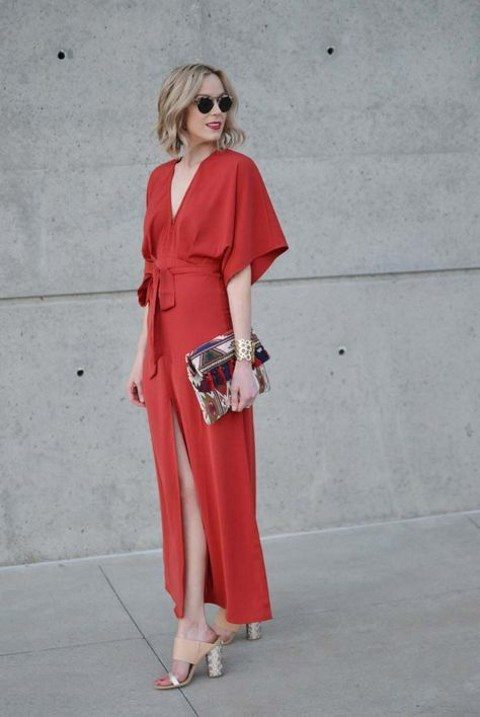 a red wrap dress, an ethic embroidered clutch and comfy heels