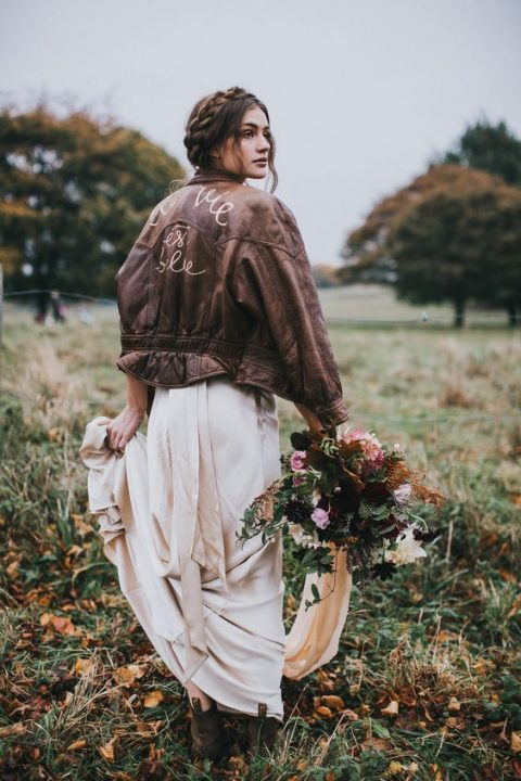 a romantic blush wedding dress, brown leather booties and a brown leather jacket