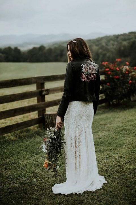 a sheath lace wedding dress and a black leather jacket is a gorgeous contrasting combo