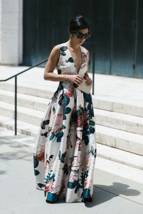 a sleeveless maxi gown with a plunging neckline and large realisticc flower prints looks wow