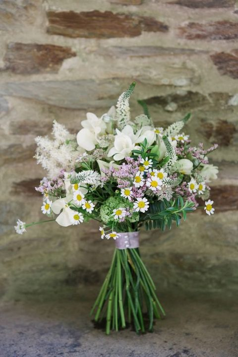 a soft-colored bouquet with white and lilac blooms and a lilac wrap