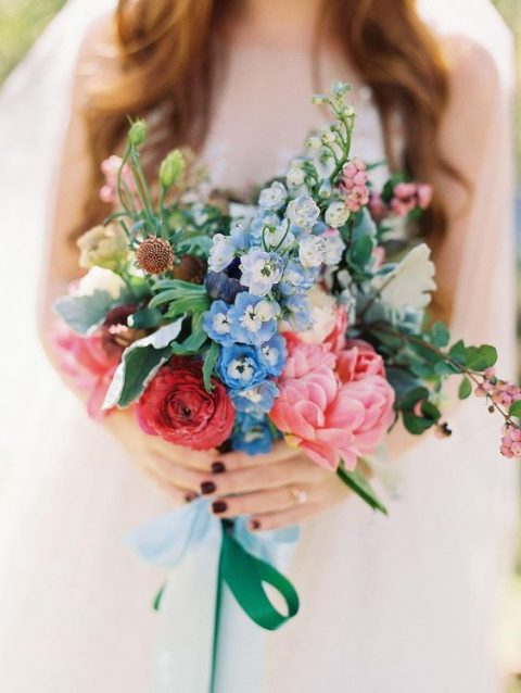 a summer bouquet with blue, pink, red flowers and greenery