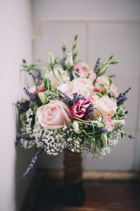 a tender bouquet with blush roses, lavender, baby_s breath and white blooms