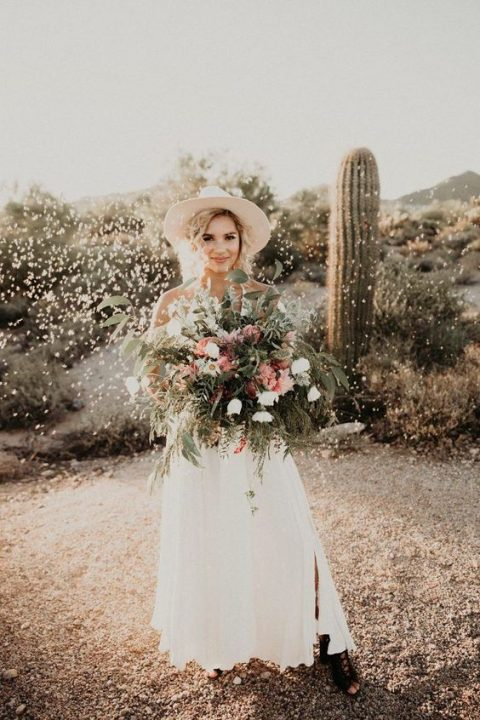 add a boho touch to the bridal look with a hat and brown lace up booties