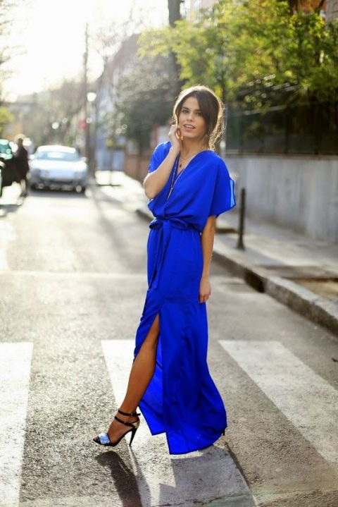 an electric blue wrap dress with a V-neckline and metallic shoes