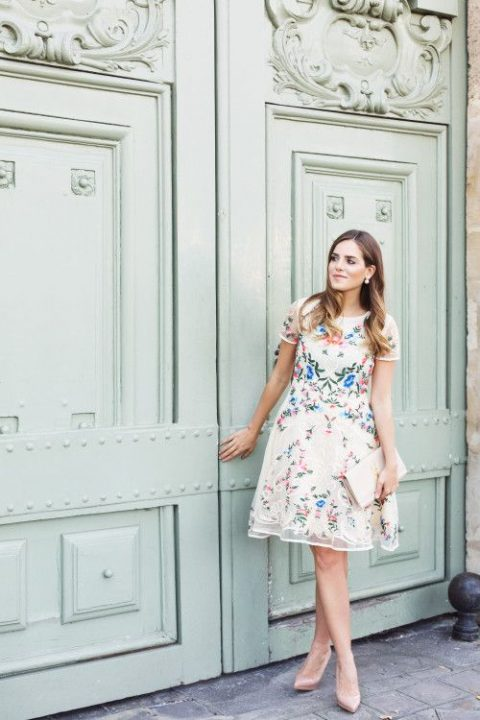 an embroidered organza floral dress with a high neckline and short sleeves