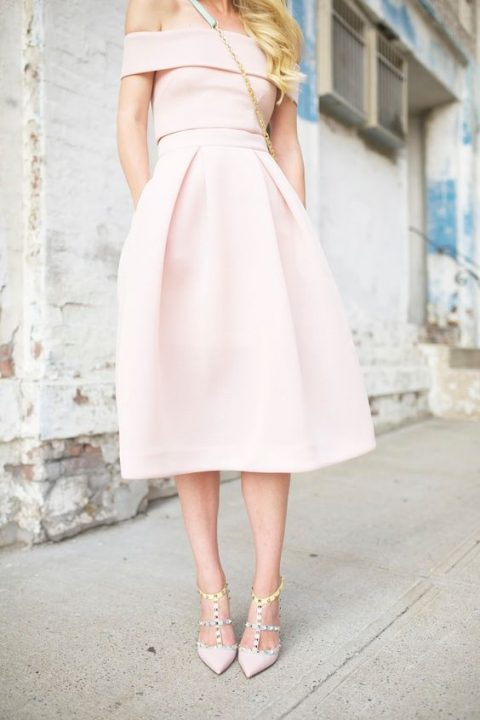 an ice pink off the shoulder dress with a midi skirt, light pink studded heels