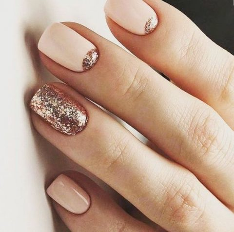 blush and creamy nails with rose gold glitter touches and an accent one