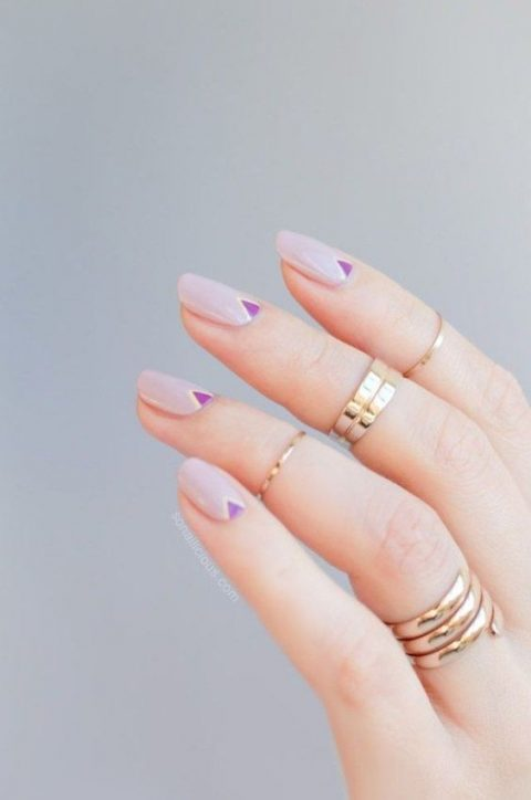 lilac nails with purple tirangle accents