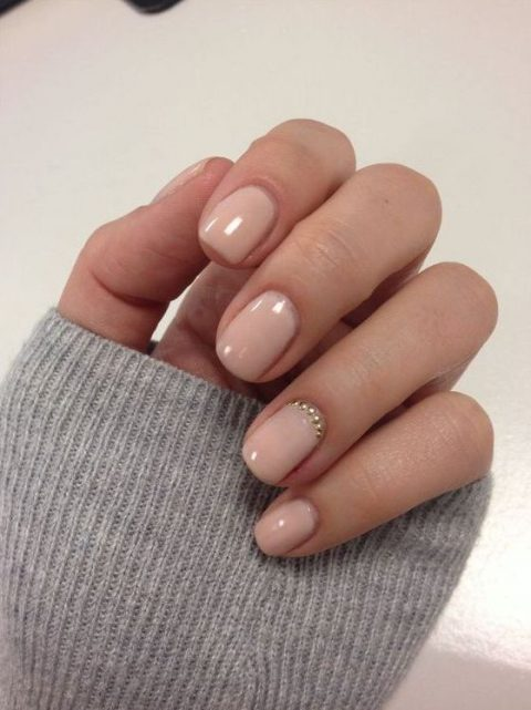 nude nails with accent beads
