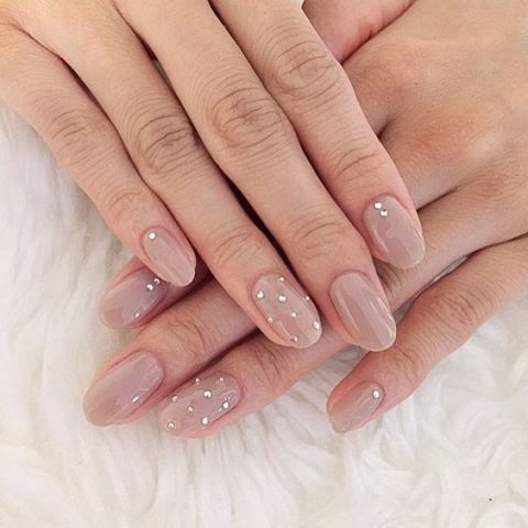 nude nails with little rhinestones look cute