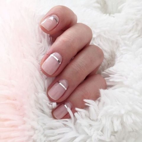 nude nails with silver stripes for a modern look