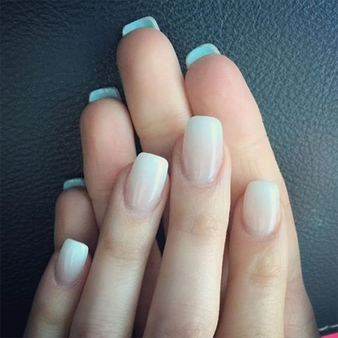 ombre French manicure with a touch of something blue