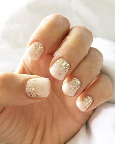 white manicure with gold sequins