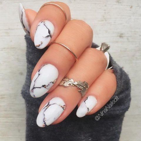 white marble manicure with glitter touches