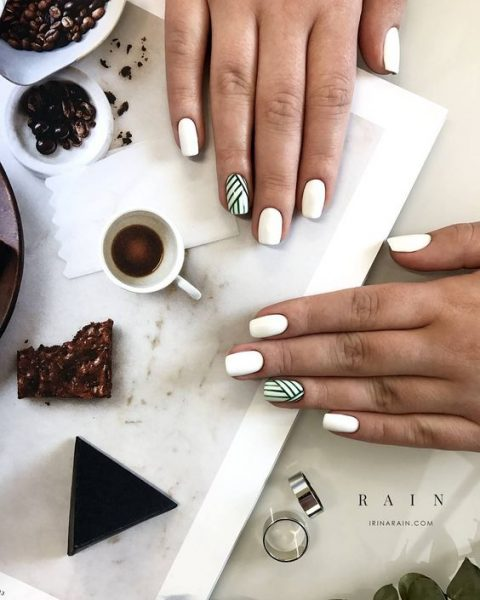 white nails with a touch of geometry as an accent