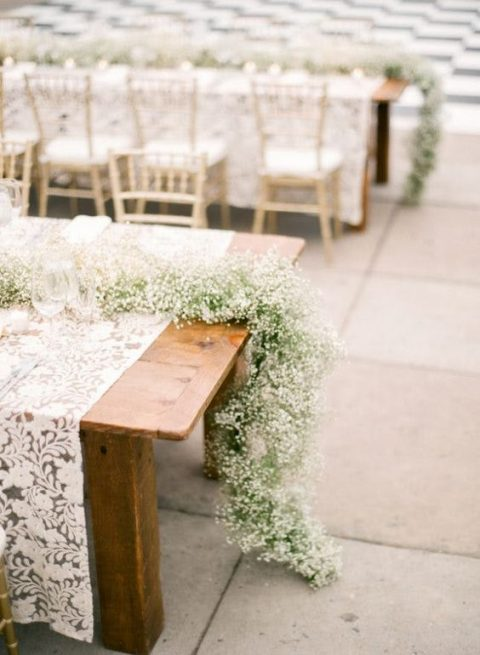 a baby_s breath table runner for a rustic wedding