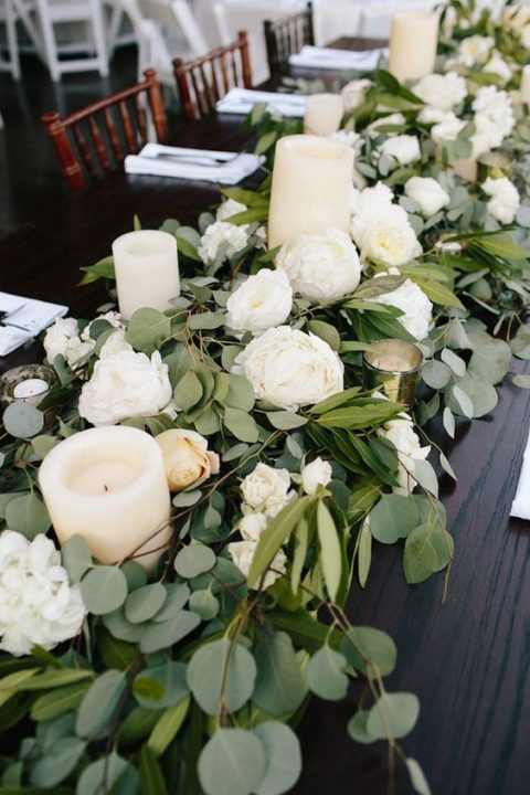 a eucalyptus table runner, white blooms and pillar candles