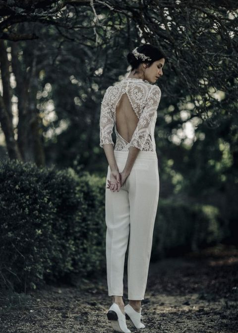 a jumpsuit with a lace bodice, long sleeves, cutout back and cropped pants