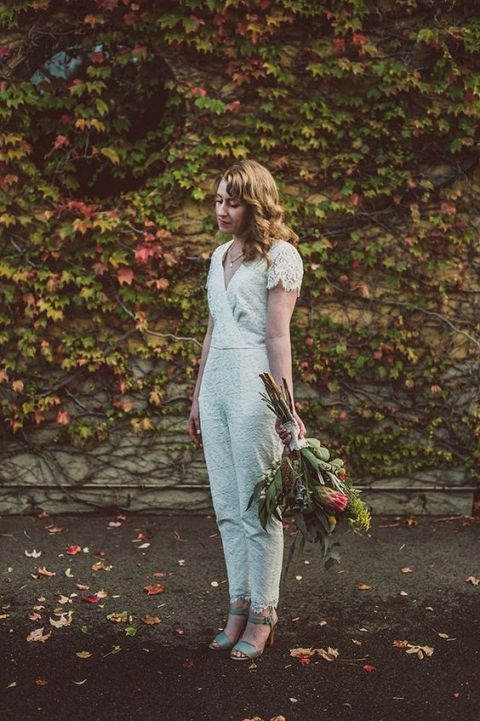 a lace fitting jumpsuit with a V neckline and cap sleeves, mint shoes