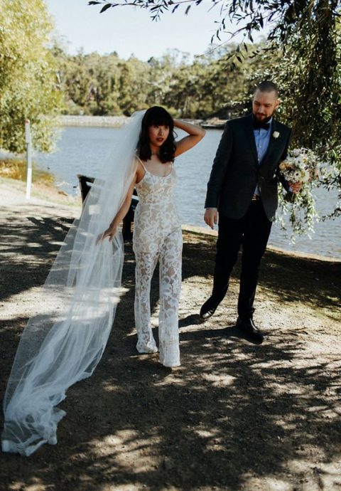 a lace spaghetti strap jumpsuit and a long veil for a unique look