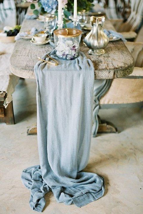 a light blue fabric table runner is a great idea for _something blue_