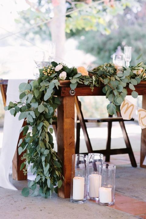 a lush eucalyptus table runner, white and blush blooms