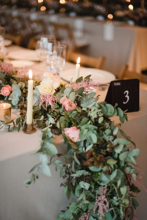 a lush eucalyptus table runner, with pink and white blooms